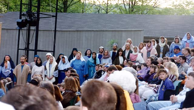 cast singing among audience