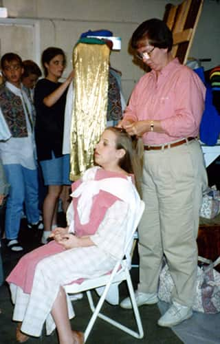 fixing hair backstage