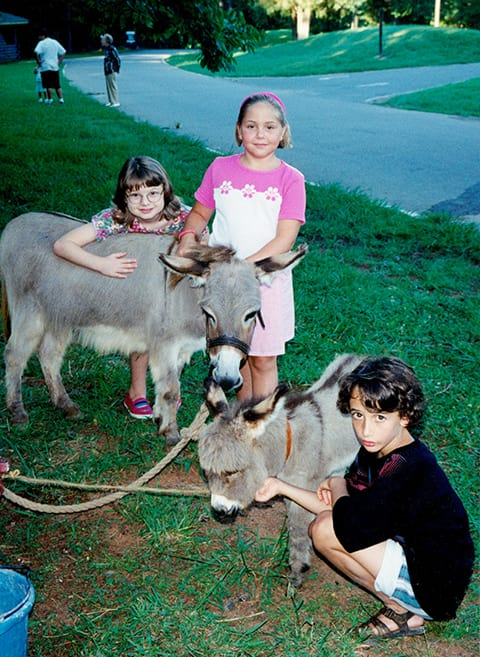 kids with miniature donkeys